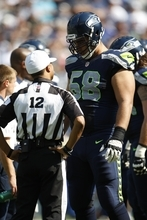 NFL referee Donovan Briggins during the game between the Dallas Cowboys and Seattle Seahawks in the first half of an NFL football game, Sunday, Sept. 16, 2012, in Seattle. (AP Photo/Kevin P. Casey)