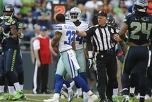 Dallas Cowboys' Orlando Scandrick walks away from a referee against the Seattle Seahawks in the second half of an NFL football game, Sunday, Sept. 16, 2012, in Seattle. (AP Photo/John Froschauer)