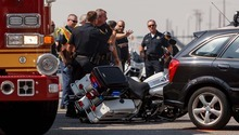 Trent Nelson  |  The Salt Lake Tribune Emergency personnel at the scene of a crash involving Salt Lake City police motorcycle officers at 400 West, 400 South in Salt Lake City, Utah, Tuesday, September 18, 2012.
