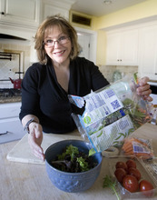 Paul Fraughton | Salt Lake Tribune  Jody Stubler, who had gastric bypass surgery three years ago, makes a salad in her kitchen. Since her surgery, exercise and eating  right have become her new way of life.