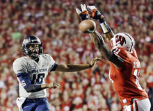 Utah State quarterback Chuckie Keeton (16) throws past Wisconsin's David Gilbert (11) during the first half of an NCAA college football game, Saturday, Sept. 15, 2012, in Madison, Wis. (AP Photo/Morry Gash)