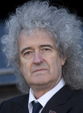 British musician Brian May Queen launches the national Team Badger campaign in London in front of a giant billboard, on Cromwell road, west London, Wednesday, Sept. 19, 2012. (AP Photo/Joel Ryan)