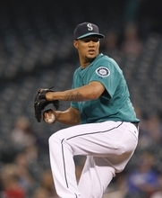 Seattle Mariners' Hector Noesi in action against the Baltimore Orioles in the first inning of a baseball game Monday, Sept. 17, 2012, in Seattle. (AP Photo/Elaine Thompson)
