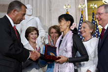 Myanmar democracy leader Aung San Suu Kyi, center, receives the Congressional Gold Medal from Speaker of the House John Boehner, at the U.S. Capitol in Washington, Wednesday, Sept. 19, 2012, as former first lady Laura Bush, back left, House Democratic Leader Nancy Pelosi, Secretary of State Hillary Rodham Clinton, and Senate Republican Leader Mitch McConnell, watch. (AP Photo/Jacquelyn Martin)