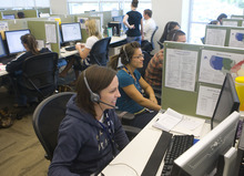 Al Hartmann  |  Tribune file photo APX Alarm techinical support representatives help customers with questions on their security systems. A majority share of the company, now named Vivint, is being acquired by Blackstone, the private equity firm.
