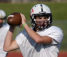 Steve Griffin | The Salt Lake Tribune Park City High School quarterback Ian Moritz eyes a receiver during practice at the school.