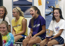 Scott Sommerdorf  |  The Salt Lake Tribune              Riley Jacobs Ireland Dunn, second from right, laughs with team members, including Regyn Youngberg, second from left, and Riley Jacobs, far right, during a team meeting Friday, September 14, 2012. Dunn, a freshman on the Davis girls soccer team is having a terrific season.