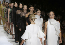 Models wear creations part of the Gucci women's Spring-Summer 2013 collection that was presented in Milan, Italy, Wednesday, Sept.19, 2012. (AP Photo/Luca Bruno)