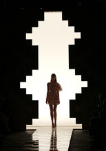 A model wears a creation part of the Mila  Schon Women's Spring-Summer 2013 fashion collection, during the fashion week in Milan, Italy, Wednesday, Sept. 19, 2012. (AP Photo/Antonio Calanni)