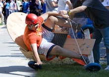 Paul Fraughton | The Salt Lake Tribune Shabir Aminzada, a Rowland Hall sophomore, carries too much speed into the corner and crashes at the bottom of a hay bale lined course on the sidewalk south of the school. The cars, built by the students earlier in the day, were part of a science lesson dealing with potential and kinetic energy. The event was part  of the school's