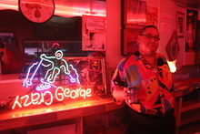 Rick Egan  | The Salt Lake Tribune   Kitty Pappas' son, waiter Crazy George, says he earned the nickname, enshrined in one of the restaurant's neon signs, for his habit of wearing shorts despite the temperature. George has been serving his mother's food for 30 years at the Kitty Pappas Steak House in Woods Cross.