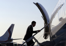 Republican presidential candidate and former Massachusetts Gov. Mitt Romney boards his campaign charter plane at Love Field in Dallas, Wednesday, Sept. 19, 2012.  (AP Photo/Charles Dharapak)