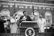 In this Nov. 22, 1963 photo provided by the The Sixth Floor Museum at Dealey Plaza, John F. Kennedy speaks outside the Hotel Texas in Fort Worth, Texas. An exhibit opening next year at the Dallas Museum of Art will feature almost all of the works of art gathered from museums and prominent Fort Worth citizens for the hotel suite Kennedy and first lady Jacqueline Kennedy stayed in the night before he was assassinated. (AP Photo/The Sixth Floor Museum at Dealey Plaza)