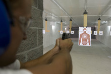 Paul Fraughton | Salt Lake Tribune A shooter at Doug's Shoot N Sport's gun range takes aim at a human-shaped target. Lawmakers are questioning a ban on such targets at public run ranges.   Wednesday, September 19, 2012