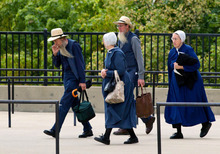 Members of the Amish community enter the U.S. Federal Courthouse in Cleveland on Wednesday, Sept. 19, 2012.  Jurors are beginning a third day of deliberations in the trial of 16 people accused of hate crimes in hair- and beard-cutting attacks against fellow Amish in Ohio. (AP Photo/Scott R. Galvin)