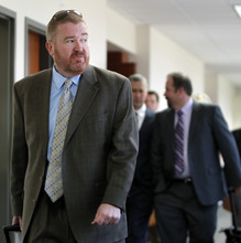 Defense Attorney Daniel King, left, leads the defense team out of the courtroom after a hearing for suspected theater shooter James Holmes in district court in Centennial, Colo., on Thursday, Sept. 20, 2012.  Holmes has been charged in the shooting at the Aurora theater on July 20 that killed twelve people and injured more than 50. (AP Photo/Ed Andrieski)