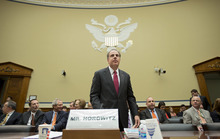 Michael Horowitz, the Justice Department's inspector general, arrives to testify before the House Oversight and Government Reform Committee a day after he faulted the department for disregard of public safety in