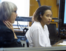 Annette Morales-Rodriguez, right, appears at her Milwaukee trial on Tuesday, Sept. 18, 2012, to face charges that she killed a pregnant woman and tried to steal her full-term fetus. Her defense attorney, Debra Patterson, left, told jurors the homicides weren't intentional, and that her client never meant for the mother or baby to die.(AP Photo/Dinesh Ramde)