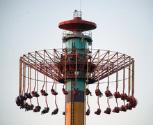 People on the Windseeker ride at Knott's Berry Farm are stuck a few hundred feet off the ground Wednesday, Sept. 19, 2012, in Buena Park, Calif. The ride held about 20 people in suspended above ground as the park's ride maintenance crews worked to get the passengers down_the riders were brought down a couple hours later and the park closed. (AP Photo/The Orange County Register, Rod Veal)