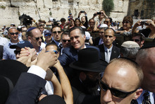 FILE - In this Sunday, July 29, 2012 file photo, Republican presidential candidate and former Massachusetts Gov. Mitt Romney greets the crowd after he visits the Western Wall in Jerusalem. Mitt Romney is undermining hopes for peace and democracy in the Middle East, a senior Palestinian official said Thursday, Sept. 20, 2012, in response to recent remarks to donors by the Republican presidential candidate that Palestinians have