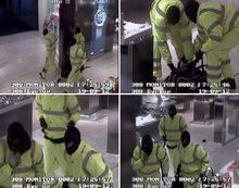 Greater Manchester Police handout CCTV stills showing masked raiders stealing a 500,000 pounds ($810,000) haul of luxury watches from high end department store Selfridges in Manchester, northern England  late Wednesday Sept 19 2012. They walked into the premises in Exchange Square wearing high visibility jackets and trousers shortly after 1800 pm . Police said the trio then smashed display cabinets with an axe and crowbars and stole 100 watches by luxury makers such as Cartier, Jaeger le Coultre and Hublot..(AP Photo/ Greater Manchester Police)