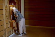 A church member kisses the icon of Jesus as she arrives for a mass at St. Mary and St. Verena Orthodox Coptic Church in Anaheim, Calif., Wednesday, Sept. 19, 2012. (AP Photo/Jae C. Hong)