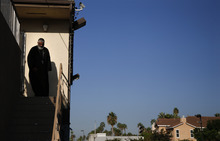 Rev. Joseph Boules, left, walks down the steps to lead a mass at St. Mary and St. Verena Orthodox Coptic Church in Anaheim, Calif., Wednesday, Sept. 19, 2012. (AP Photo/Jae C. Hong)
