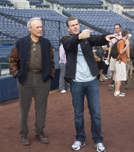 Director Robert Lorenz (right) confers with his star, Clint Eastwood, on the set of the baseball movie