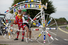 Professional cyclist Kathryn Bertine of Saint Kitts and Nevis, right, poses with cycling fan and bicycle constructor Didi Senft of Germany on the course of the road race of the Road World Championship Cycling near Valkenburg, southern Netherlands, Thursday Sept. 20, 2012. (AP Photo/Peter Dejong)