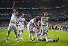 Real Madrid's players celebrate after scoring their second goal against Manchester City during a Champions League Group D soccer match at the Santiago Bernabeu Stadium, in Madrid, Tuesday, Sept. 18, 2012. (AP Photo/Daniel Ochoa De Olza)