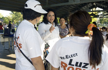 Kim Raff | The Salt Lake Tribune State Sen. Luz Robles, D-Salt Lake City, talks to volunteers during a Latino voter outreach event in Riverside Park in Salt Lake City. Democrats know they have an advantage over Republicans with Latino voters and point to the signal sent by having nine Latino Democratic candidates for legislative seats compared to just one for the GOP.
