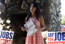 Kim Raff | The Salt Lake Tribune Melodia Gutierrez talks to volunteers during a Latino voter outreach event in Riverside Park in Salt Lake City on Wednesday evening.