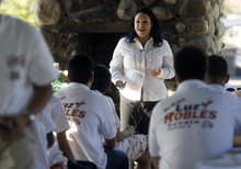 Kim Raff | The Salt Lake Tribune State Sen. Luz Robles, D-Salt Lake City, talks to volunteers during a Latino voter outreach event in Riverside Park in Salt Lake City on Wednesday evening.