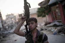 In this Wednesday, Sept. 19, 2012 photo,a Free Syrian Army fighter soldier stands at the front line in the Amariya district in Aleppo, Syria. (AP Photo/Manu Brabo)