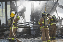 Chris Detrick  |  The Salt Lake Tribune Unified Fire fighters work at putting out hot spots at house fire at 3785 West Dimrall Drive Thursday September 20, 2012.