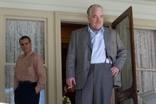 This film image released by The Weinstein Company shows Joaquin Phoenix, left, and Philip Seymour Hoffman in a scene from