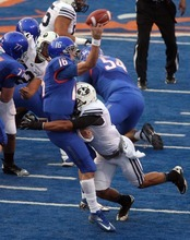 Boise State quarterback Joe Southwick gets his pass off just before a hit by BYU defensive back Preston Hadley Thursday Sept. 20, 2012 at Bronco Stadium in Boise.