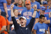 A BYU fan cheers at the beginning of the Boise State game at Bronco Stadium on Thursday September 20, 2012.