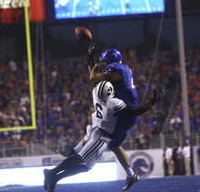 Jordan Johnson #6 of the BYU Cougars breaks up a fourth-down pass intended for receiver Matt Miller #2 of the Boise State Broncos at Bronco Stadium on Thursday September 20, 2012.