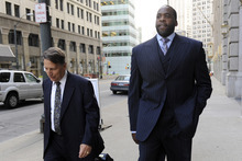 In a Sept. 6, 2012 photo, former Detroit Mayor Kwame Kilpatrick walks to federal court on Thursday, Sept. 6, 2012 in Detroit with attorney Jim Thomas. Opening statements are set for Friday, Sept. 21. Kilpatrick, his father Bernard, former city water boss Victor Mercado and Kilpatrick pal Bobby Ferguson are accused of a sweeping corruption scheme. (AP Photo/Detroit News, David Coates)  DETROIT FREE PRESS OUT; HUFFINGTON POST OUT