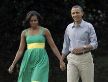 FILE - In this June 27, 2012 file photo, President Barack Obama and his wife, Michelle, arrive at the Congressional picnic on the South Lawn of the White House in Washington. The Democratic president and first lady will tape an episode of