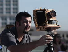 Aris Westbrock sets up a 4x5 camera to try to get a photo as the  space shuttle Endeavor passes over Sacramento, Calif., Friday, Sept. 21, 2012. Endeavour is making a final trek across the country to the California Science Center in Los Angeles, where it will be permanently displayed.(AP Photo/Rich Pedroncelli