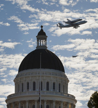 Space Shuttle Endeavour mounted on NASA's Shuttle Carrier Aircraft, passes over the California state Capitol, Friday, Sept. 21, 2012,  in Sacramento, Calif. Endeavour is making a final trek across the country to the California Science Center in Los Angeles, where it will be permanently displayed.(AP Photo/The Sacramento Bee, Lezlie Sterling)