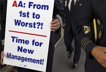 (AP Photo/M. Spencer Green) American Airline pilots have set up protest lines at airports to call attention to their frustration over cut jobs and benefits changes.