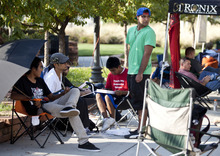 Lennie Mahler  |  The Salt Lake Tribune Chance Lameman, the first in line, and others wait at the Gateway Mall for the new iPhone 5 on Thursday, Sept. 20, 2012. The doors to the Apple Store open Friday, Sept. 21, at 7:30 a.m.