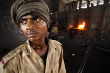 An Indian laborer looks on as he works inside a steel factory on the outskirts of Jammu, India, Friday, June 1, 2012. India's economic growth slowed to 5.3 percent in the January-March quarter, the lowest in nine years, as the malaise in manufacturing and other sectors spread to ordinary Indians, who trimmed spending. (AP Photo/Channi Anand)