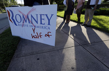 Protesters stand outside of the University of Miami where Republican presidential candidate Mitt Romney was attending a Meet the Candidates forum held by Univision, Wednesday, Sept. 19, 2012, in Coral Gables, Fla. (AP Photo/Lynne Sladky)