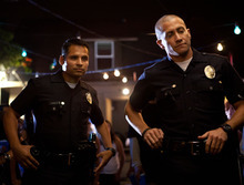 Michael Pena, left, and Jake Gyllenhaal in a scene from