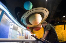 Kim Raff |  The Salt Lake Tribune Nathan Roberts looks at the solar system exhibit at Clark Planetarium in Salt Lake City on Thursday, Sept. 20, 2012. Ticket prices will go up starting Oct. 1.