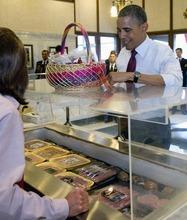 President Barack Obama picks out sausages at Usinger's Sausage, Saturday, Sept. 22, 2012, in Milwaukee. (AP Photo/Carolyn Kaster)